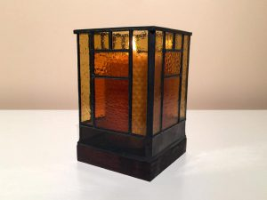 Three quarter view of stained-glass votive candle holder