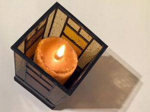 Top three quarter view of stained-glass votive candle holder